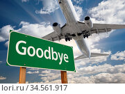 Goodbye Green Road Sign and Airplane Above with Dramatic Blue Sky... Стоковое фото, фотограф Zoonar.com/Andy Dean Photography / age Fotostock / Фотобанк Лори