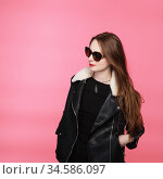 fashion model wearing black in sunglasses, beautiful young woman. leather jacket, studio shot. Стоковое фото, фотограф Nataliia Zhekova / Фотобанк Лори