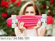 Lovely urban girl with a pink skateboard. Стоковое фото, фотограф Nataliia Zhekova / Фотобанк Лори