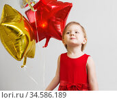 Little baby girl with colorful shiny foil balloons. Стоковое фото, фотограф Nataliia Zhekova / Фотобанк Лори