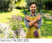 indian gardener or farmer with box of garden tools. Стоковое фото, фотограф Syda Productions / Фотобанк Лори