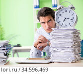 Businessman having problems with paperwork and workload. Стоковое фото, фотограф Elnur / Фотобанк Лори