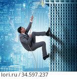 The businessman climbing skyscraper in challenge concept. Стоковое фото, фотограф Elnur / Фотобанк Лори