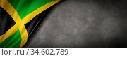 Jamaica flag on concrete wall. Horizontal panoramic banner. 3D illustration. Стоковое фото, фотограф Zoonar.com/Laurent Davoust / age Fotostock / Фотобанк Лори