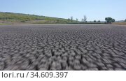 Drought deep cracked earth under blue sky. Стоковое видео, видеограф Сергей Старуш / Фотобанк Лори