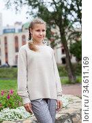 Pre-teen Caucasian girl wearing beige blouse and grey breeches standing outdoor, posing for camera. Стоковое фото, фотограф Кекяляйнен Андрей / Фотобанк Лори