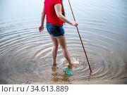 A partial body view of a woman's legs standing in lake water. Стоковое фото, фотограф Joseph De Sciose / age Fotostock / Фотобанк Лори