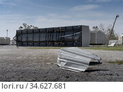 Lake Charles, Louisiana. USA - September 6, 2020:  Hurricane Laura. Destruction from strong winds. Upside down mobile home. Iron lying on the ground. Стоковое фото, фотограф Ирина Кожемякина / Фотобанк Лори
