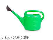 Old green garden watering can isolated on a white background. Стоковое фото, фотограф Zoonar.com/Micha Klootwijk / age Fotostock / Фотобанк Лори