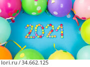 new year 2021 party date with balloons. Стоковое фото, фотограф Syda Productions / Фотобанк Лори