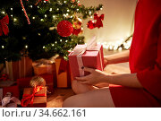 close up of woman with gift box at christmas tree. Стоковое фото, фотограф Syda Productions / Фотобанк Лори