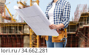 female builder with blueprint and working tools. Стоковое фото, фотограф Syda Productions / Фотобанк Лори