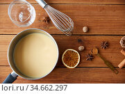 pot with eggnog, ingredients and spices on wood. Стоковое фото, фотограф Syda Productions / Фотобанк Лори