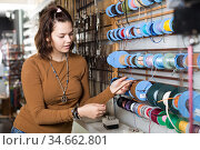 Young girl seller offering leather and textile braids. Стоковое фото, фотограф Яков Филимонов / Фотобанк Лори