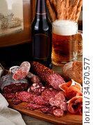 Antipasti dish with bacon, jerky, salami, crispy grissini with cheese... Стоковое фото, фотограф Zoonar.com/Maryna Voronova / easy Fotostock / Фотобанк Лори