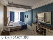 Interior of a hotel room with two beds. Стоковое фото, фотограф Володина Ольга / Фотобанк Лори