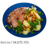 Served dish with fried pork, herbs and potatoes. Стоковое фото, фотограф Яков Филимонов / Фотобанк Лори