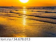 Warm winter in Israel. Delightful sunset on the Mediterranean coast... Стоковое фото, фотограф Zoonar.com/kavram / easy Fotostock / Фотобанк Лори