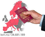 Senior man holding British passport on map of European Union in preparation... Стоковое фото, фотограф Zoonar.com/Steve Heap / easy Fotostock / Фотобанк Лори