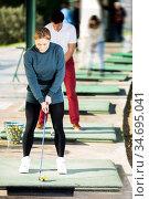 Golf partners playing together. Стоковое фото, фотограф Яков Филимонов / Фотобанк Лори