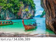 Scenic bay of Koh Lao La Ding island with thai boats, Krabi, Thailand. Стоковое фото, фотограф Zoonar.com/Ana Flašker / age Fotostock / Фотобанк Лори