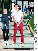 Golf players at golf course. Стоковое фото, фотограф Яков Филимонов / Фотобанк Лори