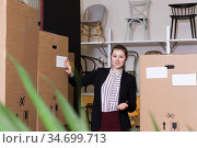 Confident woman among goods boxes in chair store. Стоковое фото, фотограф Яков Филимонов / Фотобанк Лори