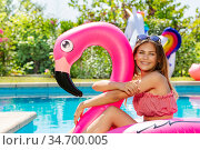 Girl portrait hug inflatable flamingo near pool. Стоковое фото, фотограф Сергей Новиков / Фотобанк Лори