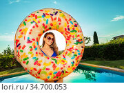 Cute girl in sunglasses and inflatable doughnut. Стоковое фото, фотограф Сергей Новиков / Фотобанк Лори