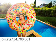 Girl in yellow bikini hold inflatable doughnut. Стоковое фото, фотограф Сергей Новиков / Фотобанк Лори