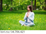 Beautiful young girl in casual clothes meditating in spring park. Стоковое фото, фотограф Zoonar.com/Tatiana Badaeva / easy Fotostock / Фотобанк Лори