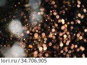 Blurred natural background with soft focus golden bokeh lights. Defocused... Стоковое фото, фотограф Zoonar.com/Arthur Mustafa / easy Fotostock / Фотобанк Лори