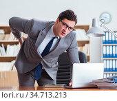 Businessman feeling pain in the office. Стоковое фото, фотограф Elnur / Фотобанк Лори