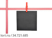 Kariertes Band und Zettel auf weißem Hintergrund - Checked ribbon... Стоковое фото, фотограф Zoonar.com/lantapix / easy Fotostock / Фотобанк Лори