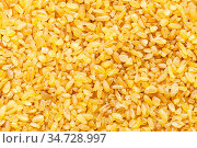 Food background - bulgur (burghul), parboiled, dried and crushed wheat... Стоковое фото, фотограф Zoonar.com/Valery Voennyy / easy Fotostock / Фотобанк Лори