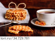 Breakfast with Waffles Stack on Napkin, White Cup of Tea and Pieces... Стоковое фото, фотограф Zoonar.com/Vsevolod Belousov / easy Fotostock / Фотобанк Лори