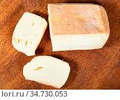 Top view of sliced local italian Taleggio cheese from cow's full milk... Стоковое фото, фотограф Zoonar.com/Valery Voennyy / easy Fotostock / Фотобанк Лори
