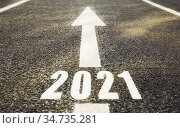 white road marking in shape of 2021 year and arrow. Стоковое фото, фотограф Syda Productions / Фотобанк Лори