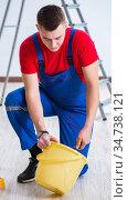 Male painter preparing for painting job at construction site. Стоковое фото, фотограф Elnur / Фотобанк Лори