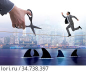 The hand cutting rope in business risk concept. Стоковое фото, фотограф Elnur / Фотобанк Лори