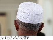 Al-Serkal Mosque. Muslim man praying with a kufi cap. Phnom Penh. ... Стоковое фото, фотограф Pascal Deloche / Godong / age Fotostock / Фотобанк Лори