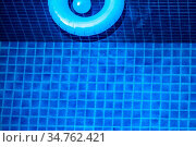 Aerial view of inflatable ring toy in swimming pool water from above... Стоковое фото, фотограф Zoonar.com/Ivan Mikhaylov / easy Fotostock / Фотобанк Лори