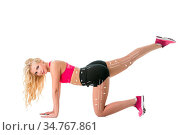Image of cute athlete doing exercise for pumping up her ass with dotted... Стоковое фото, фотограф Zoonar.com/Andrey Guryanov / easy Fotostock / Фотобанк Лори