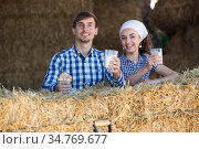 man and woman in hay with milk. Стоковое фото, фотограф Яков Филимонов / Фотобанк Лори