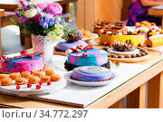 Tasty colorful cakes on the showcase with fresh summer berries. Стоковое фото, фотограф Zoonar.com/Oksana Shufrych / easy Fotostock / Фотобанк Лори