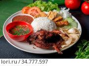 Nasi lemak kukus with quail meat, popular traditional Malaysian local... Стоковое фото, фотограф Zoonar.com/szefei / easy Fotostock / Фотобанк Лори