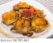 Photography of plate with fried chicken wings with barley porridge. Стоковое фото, фотограф Яков Филимонов / Фотобанк Лори