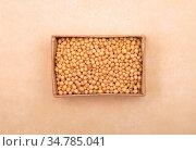 Senfkörner in Karton auf braunem Hintergrund - Mustard seeds in carton... Стоковое фото, фотограф Zoonar.com/lantapix / easy Fotostock / Фотобанк Лори