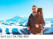 A hipster traveler with a beard wearing sunglasses in nature. A man... Стоковое фото, фотограф Zoonar.com/Ian Iankovskii / easy Fotostock / Фотобанк Лори