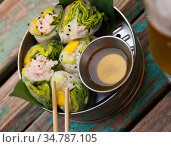 Ceviche rolls from white fish with rice paper in vietnamese style. Стоковое фото, фотограф Яков Филимонов / Фотобанк Лори